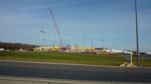 The crane is moving steel as the camera has reached the fence on November 28, 2012.