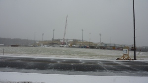 The roof takes shape as the first snowfall during construction occurs on December 9, 2012.