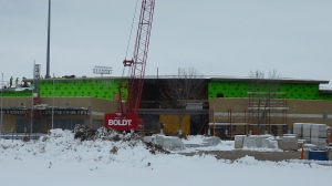 The activity is on the left with the workers up near the roof line two days after Christmas, 2012.