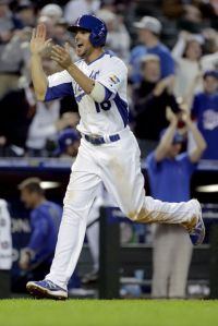 Alex Liddi celebrates for Italy. Photo Credit: AP/Charlie Riedel