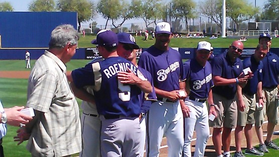 Ron Roenicke congratulates Lance Roenicke during the ceremony.