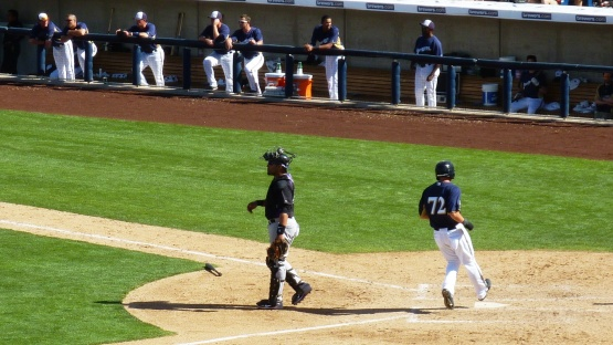 Lance Roenicke scores the go ahead run.
