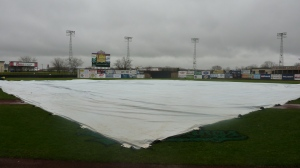 Tarp covers the field Again rain falls from the sky Who will stop the rain?