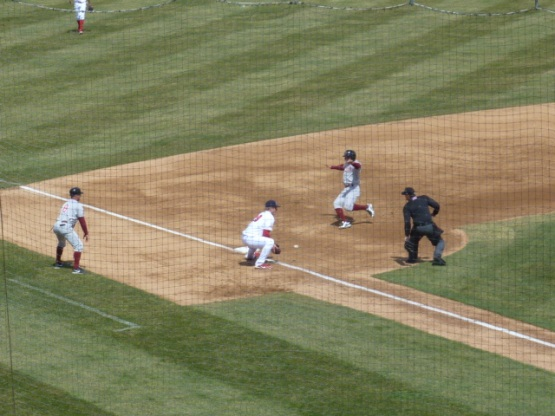 Tyrone Taylor slides in safely to third base after Orlando Arcia's RBI single in the third inning.
