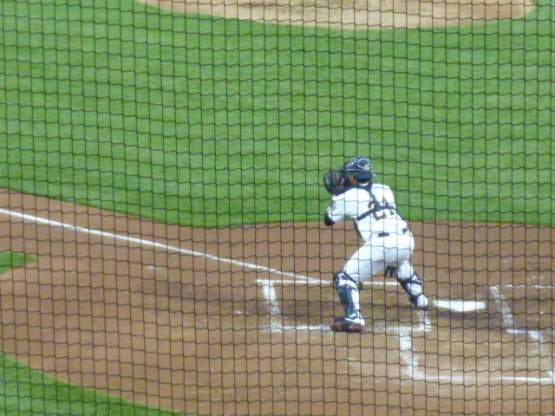 Sandy Martinez waits for the ball and Adam Giacalone at the plate after the single by Rodriguez.
