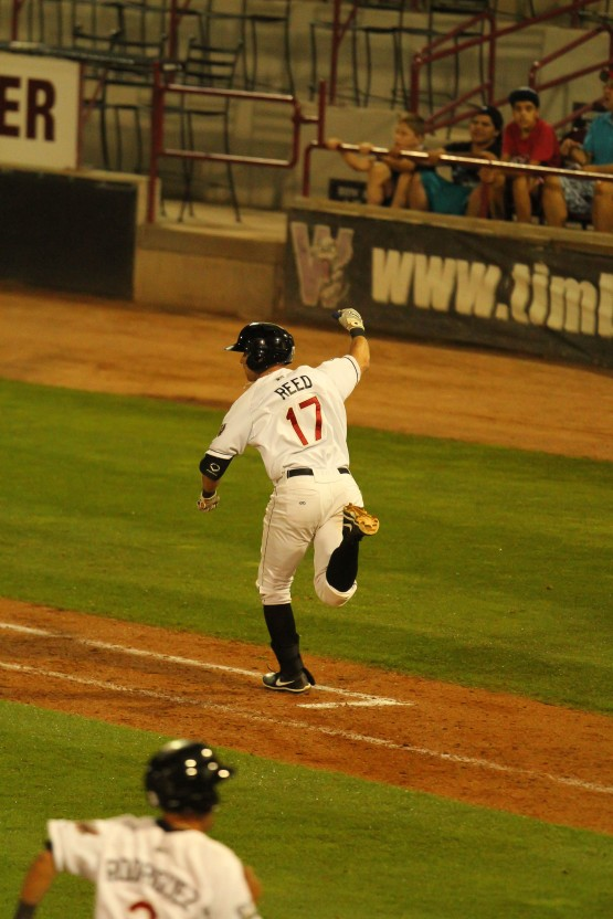 This is the uncropped photo from the game story. Reed to first as Rodriguez scores the winning run!