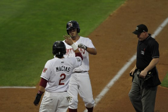 Brandon Macias greets Nick Ramirez at the plate after a home run against Clinton on September 9, 2012. (Photo Credit: Ann Mollica)