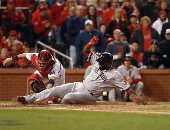 David Ortiz slides in with Boston's first run in Game Four.  (Photo Credit: Jim Davis/Globe Staff)