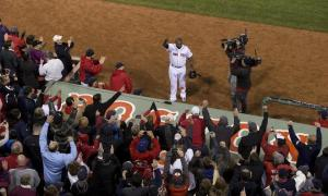 Former Timber Rattler David Ortiz takes a curtain call after his grand slam on Sunday. (STAN GROSSFELD/GLOBE STAFF)