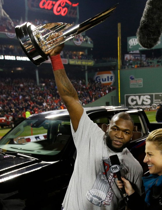 David Ortiz wins the World Series, gets a trophy, a truck, and interviewed by Erin Andrews. (Photo Credit: AP Photo/Matt Slocum)