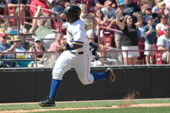 Jason Rogers rounds third and heads for home in this 2011 game. (Photo Credit: Ann Mollica)