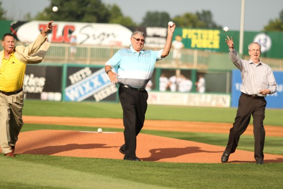 Members of the 1964 Foxes throw out a first pitch before Sunday's game.