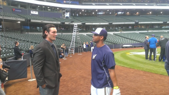 Clint Coulter and Khris Davis talk before the game at Miller Park on September 13.