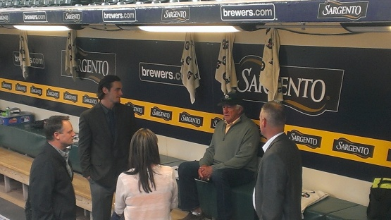 The Coulter family talks with Bob Uecker before the game.