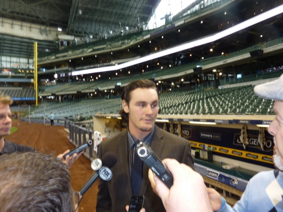 Clint Coulter meets with the media before the game.