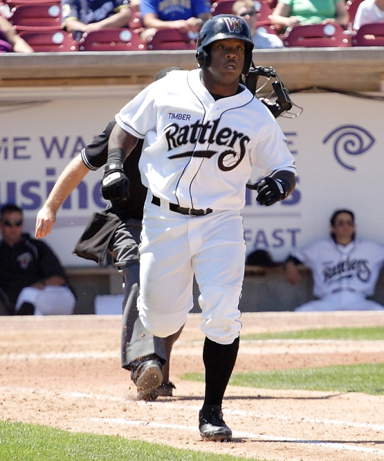 Kentrail Davis hits a home run for the Rattlers in 2010.
