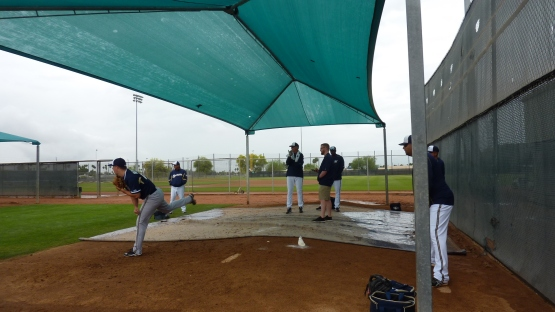 Gary Lucas and David Chavarria watch Brock Hudgens work in the bullpen.