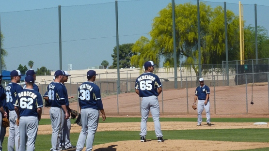 Kodi Medeiros takes the mound for a defensive drill.