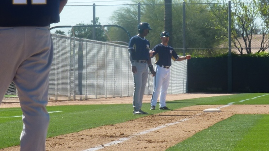 Matt Erickson coaches Luis Aviles at third base.