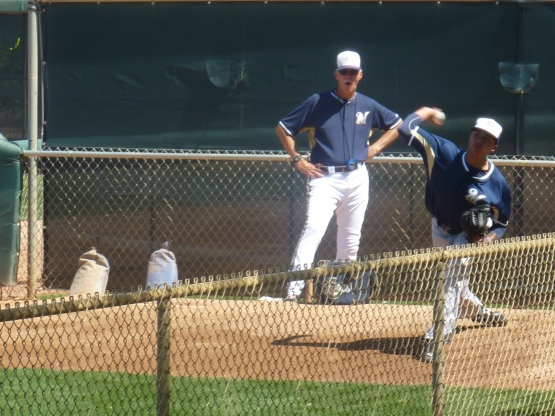 Gary Lucas watches Devin Williams warmup in the bullpen before the game.