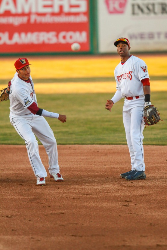 Luis Aviles and Jake Gatewood watch Gatewood's throw to first on an attempted double play in the second inning.