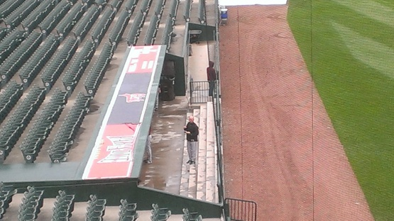 Just a manager eating breakfast on the steps of the dugout at 9:30am.