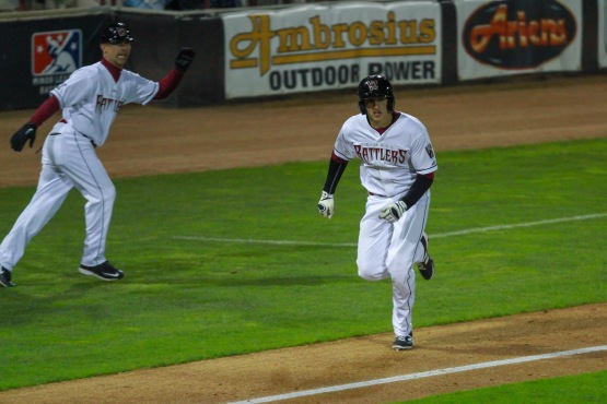 Dustin DeMuth scores in the ninth.