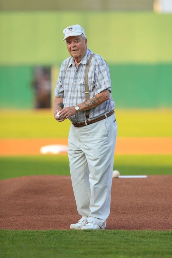 Kenneth H. Berg, who was stationed on the William J. Patterson APD104, which was alongside of the USS Missouri while the peace treaty was being signed, tosses a ceremonial first pitch on Wednesday. Berg was part of the Ceremonial Honor Guard/Security for the event in 1945.